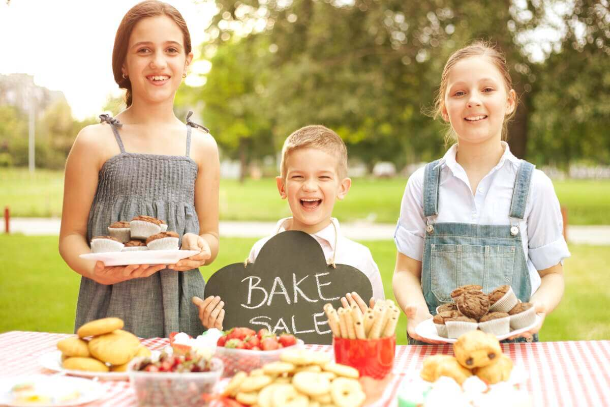 Kids selling goods at a bake sale